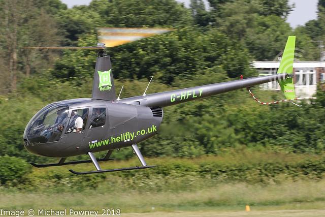 G-HFLY - 2007 build Robinson R44 Raven II, visiting Barton
