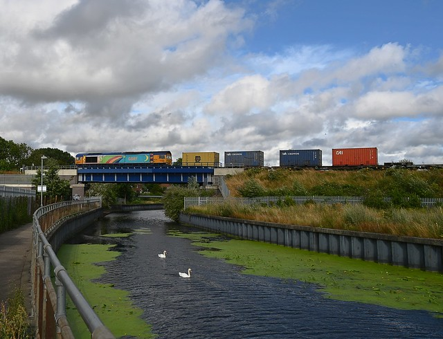 GBRf 66720 hauls 4L13, 11.14 Doncaster Railport - Felixstowe North Intermodal across the River Gipping at Boss Hall Jct, Ipswich. 30 07 2021