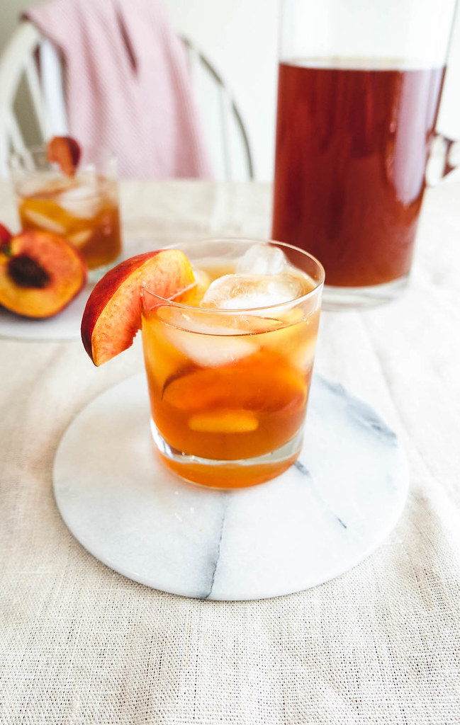 An elevated shot of the peach sweet tea and bourbon cocktail.