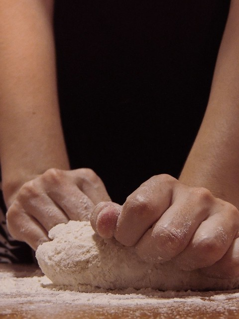 Stock photo of hands kneading bread