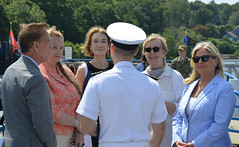 Governor Lamont, State Reps. Kathleen McCarty and Holly Cheeseman, and State Senators Osten and Somers talk with naval personnel during a bill signing at the Submarine Base in Groton.  The legislation, HB 6449 (Public Act 21-152)¸ An Act Expanding Economic Opportunity in Occupations Licensed by the Departments of Public Health and Consumer Protection¸ makes it easier for professionals in a number of fields who are licensed in other states to obtain Connecticut credentials if they have residency in the state. Particularly, this is meant to assist the spouses of service members who are permanently stationed in Connecticut. Individuals seeking a license to practice in Connecticut must meet certain experience and background requirements.