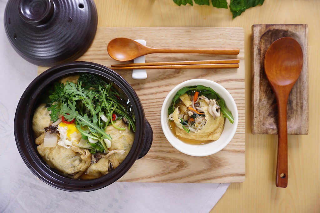 An overhead shot of soup in a Korean ttukbaegi