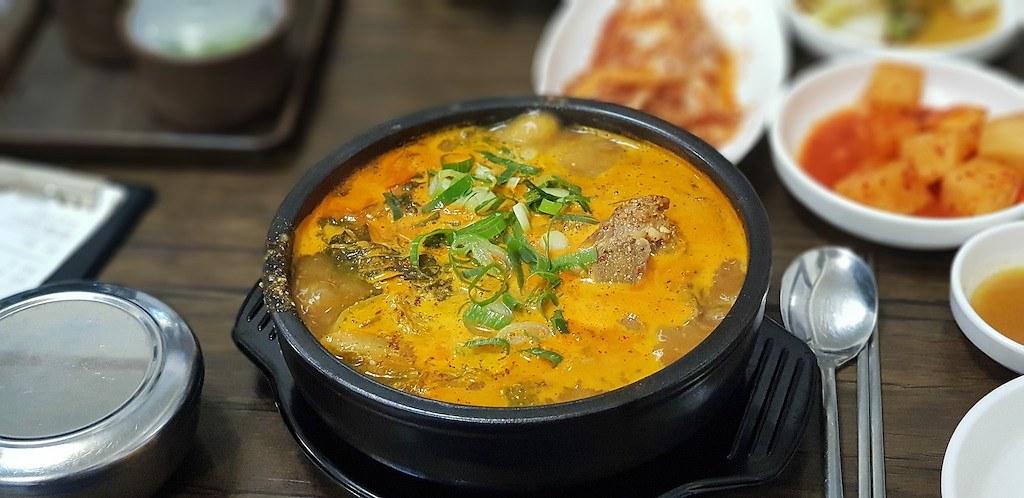 A close up shot of stew in a ttukbaegi