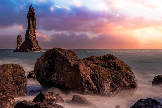 Reynisdrangar rocky stacks at Reynisfjara beach (Iceland)