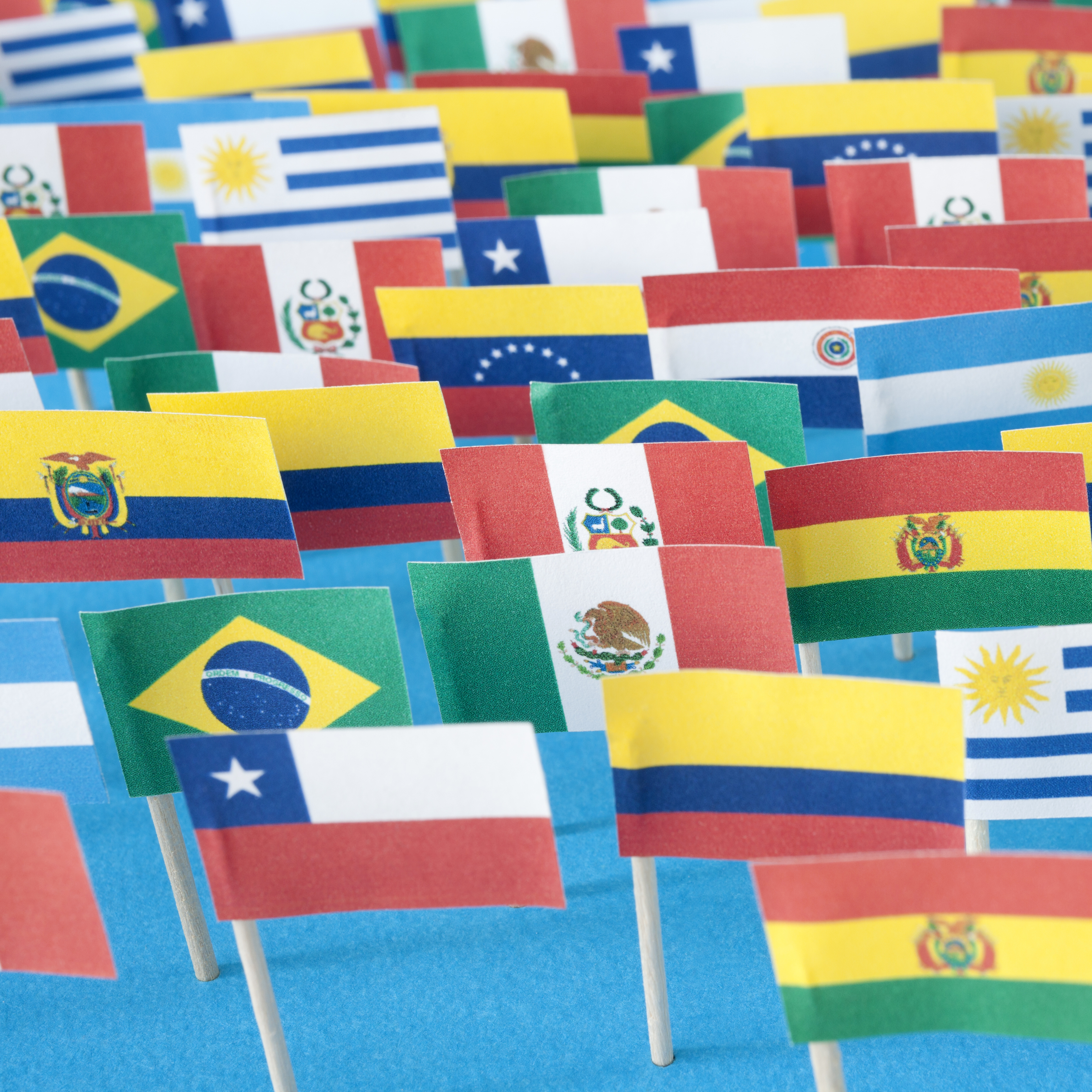 A selection of handmade flags of countries from across Latin America.