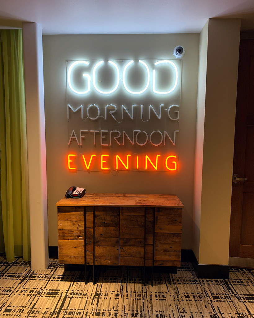 Neon sign with Good Evening lit up