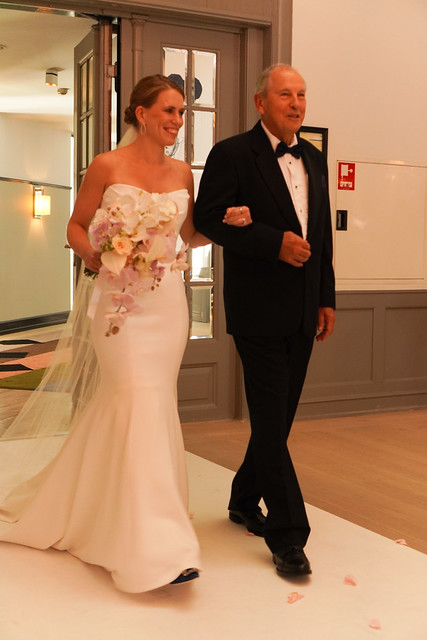 Nina enters with her dad, Tom