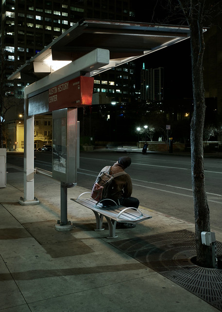 Bus Stop, bench and black beanie.