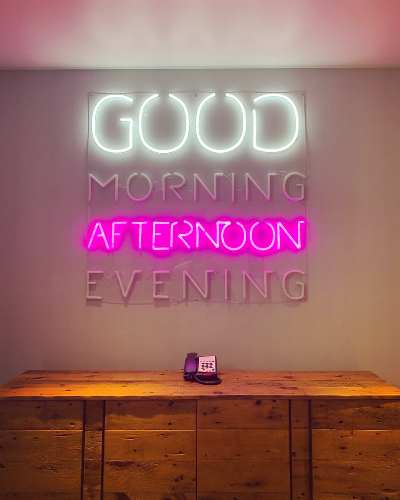 Neon sign with Good Afternoon lit up
