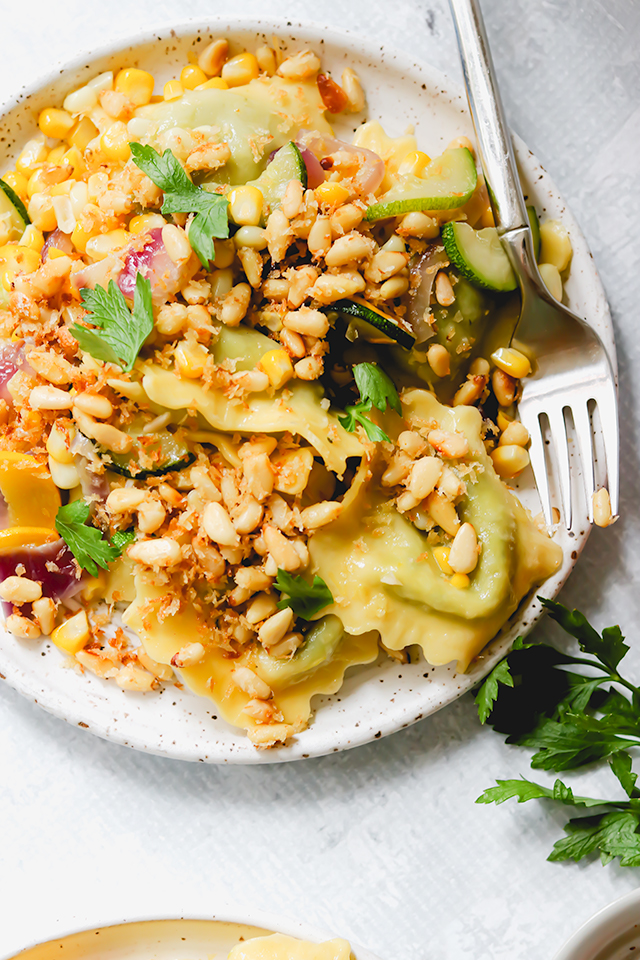 Ravioli with Zucchini, Corn, and Buttery Pine Nut Crunch