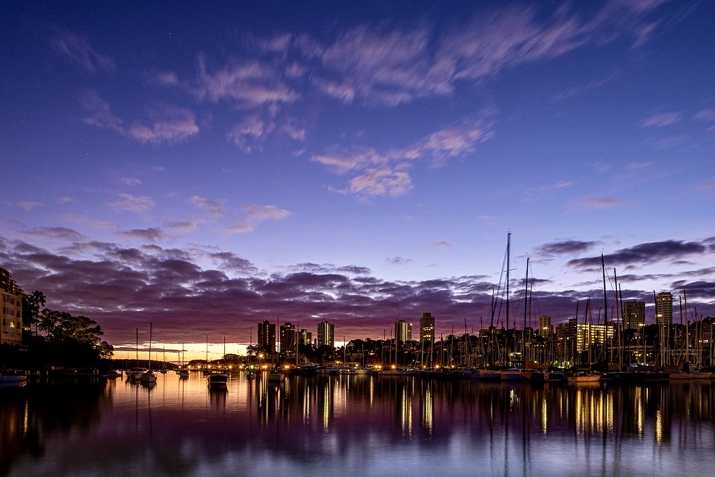 Very quiet dawn on Sydney Harbour as yachts slumber at Rushcutters Bay.