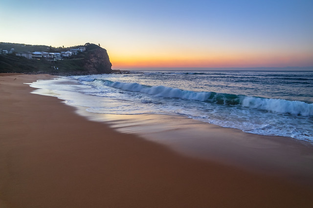 Clear skies aerial sunrise at the beach