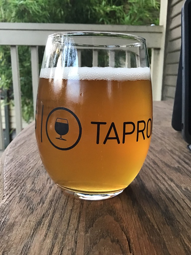 Alpha Blonde ale in glass on table outside