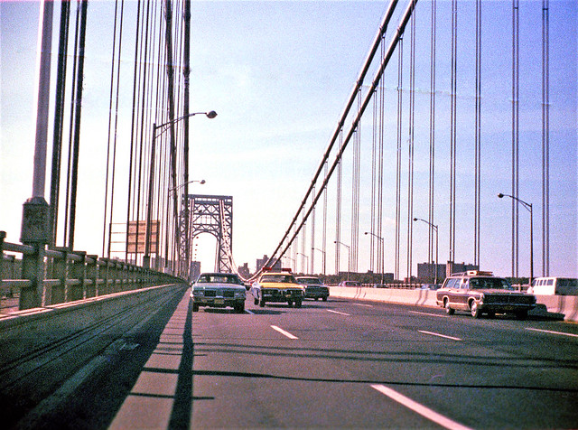 Hey, where's all the bumper to bumper traffic? A view of the George Washington Bridge heading into Manhattan from the back seat of my Dad's 1965 Pontiac Bonneville. Some daily drivers and an NY State Trooper police car in yellow and blue. New York. 1973.