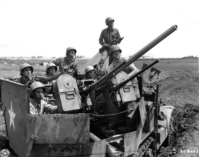 SC 208603 - An alert gun crew mans the lethal turret of this halftrack, on guard against Jap air attacks on Yontan airfield, Okinawa.