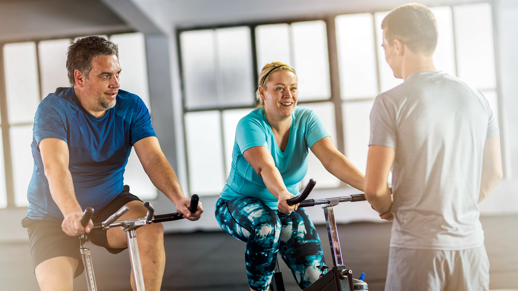 Couple on exercise bikes.