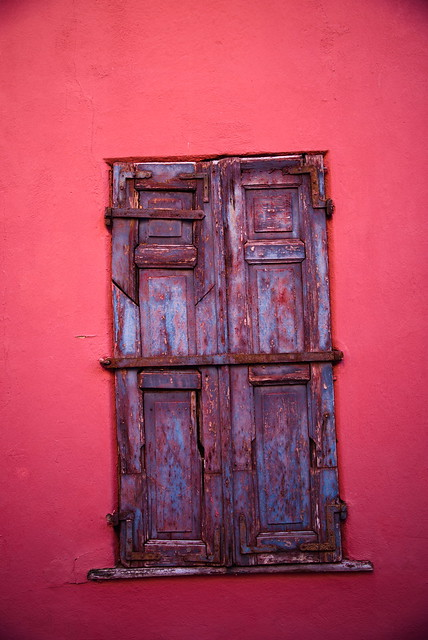 old shutters and red wall