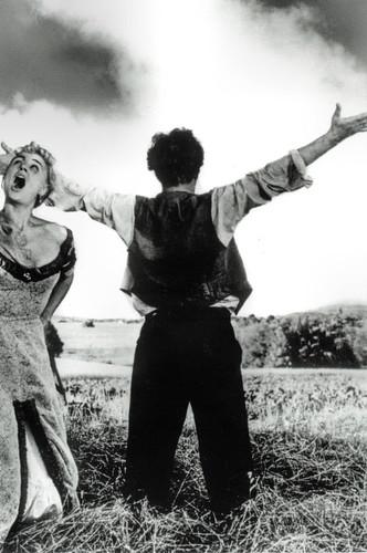 Harriet Andersson and Åke Fridel in Sommarnattens leende (1955)