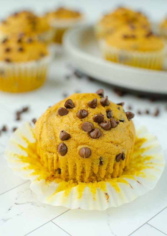 Pumpkin Chocolate Chip Muffins - fluffy and delicious pumpkin muffins with chocolate chips! These are going to be your fall favorite.