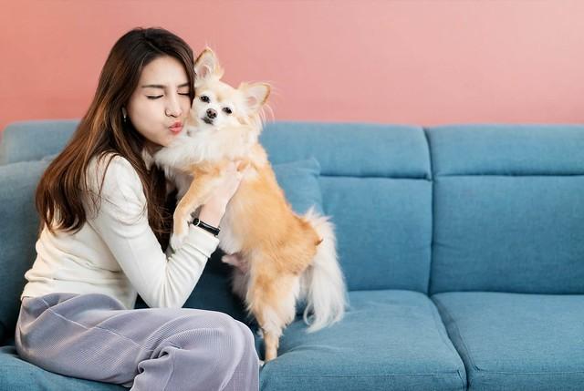 Bonding During Pandemic - Girl Hugging Dog