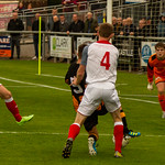 Marcus Goodall is pushed in the back for a penalty