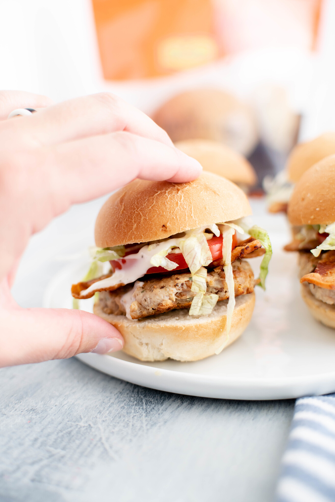 Get ready for back to school with these simple and delicious Chicken Bacon Ranch Sliders featuring Rhodes Warm & Serve rolls. They are sure to be a big hit with the family.