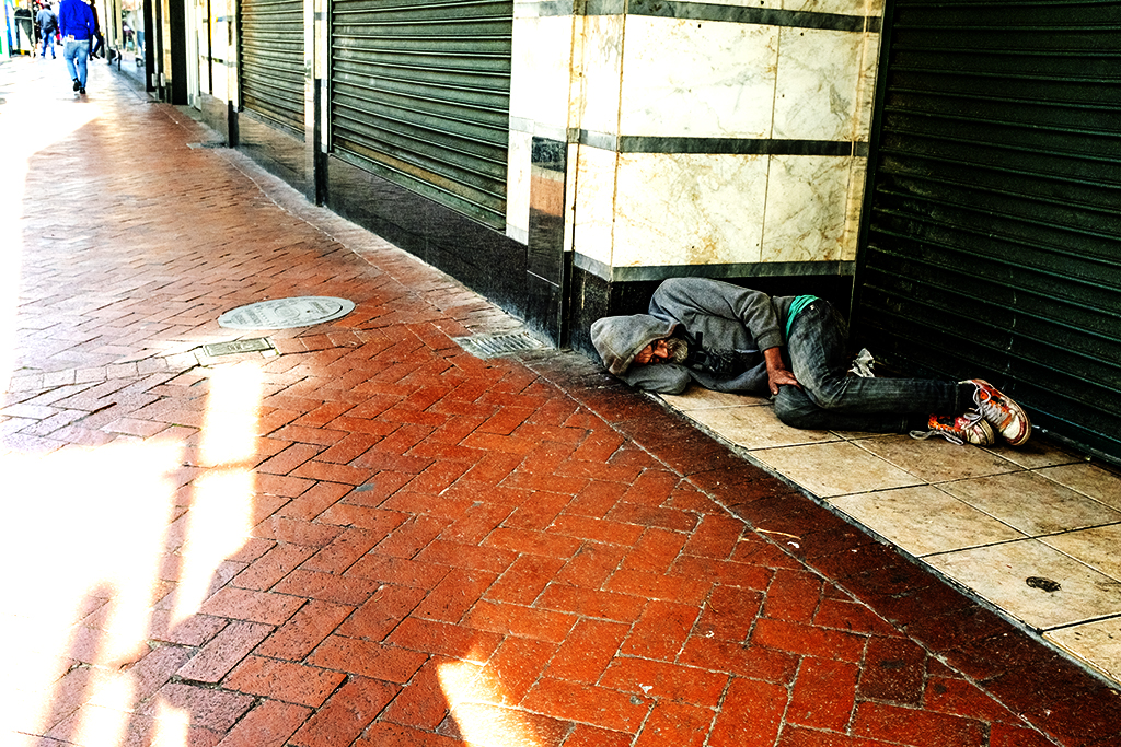 Old white man lying on sidewalk on 8-16-21--Cape Town