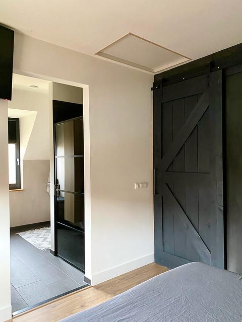 Woning boerderijstijl badkamer en suite staldeur