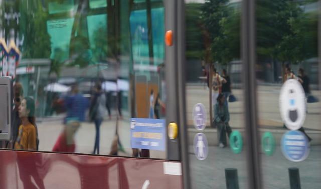 Street life on a bus window