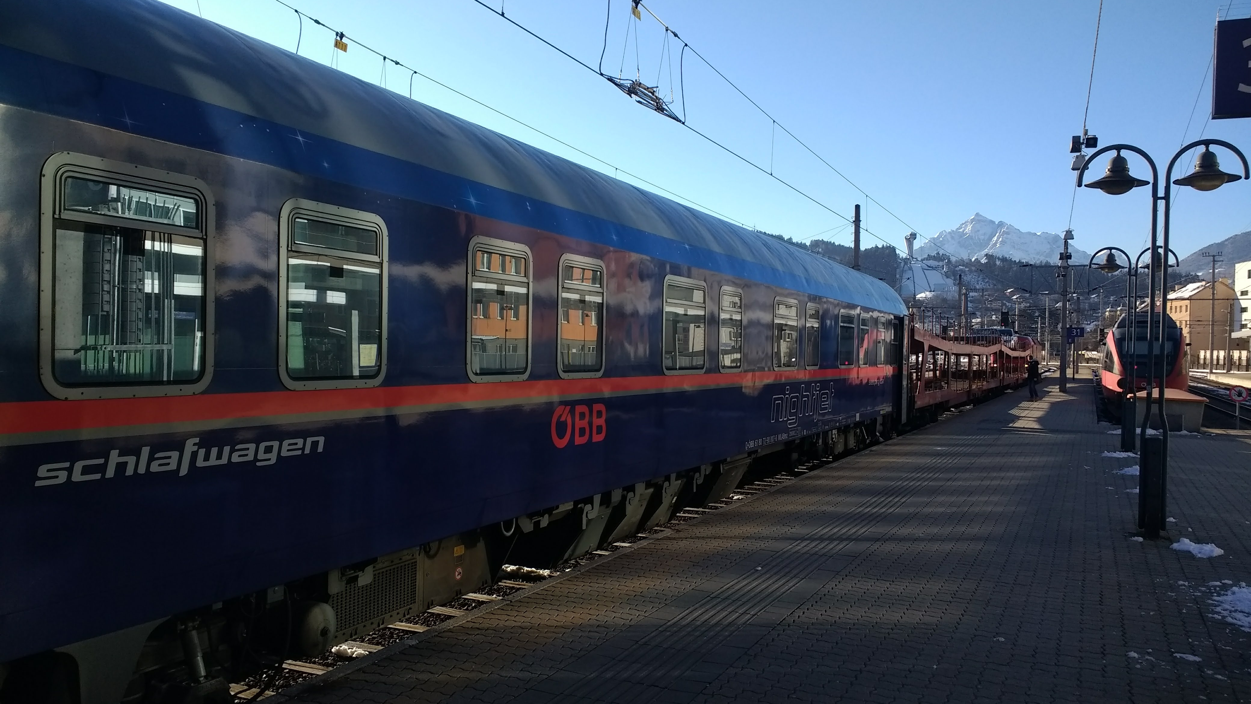 A German train. We can see a mountain in the background.