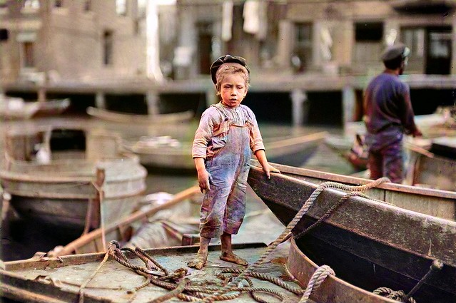 Lewis Wickes Hine , young fisherman, colorized by Ahmet Asar