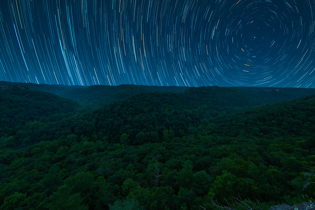 The night sky moves over Red River Gorge