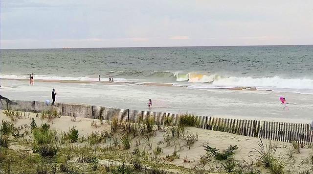 Beach overrun by dregs of Henri