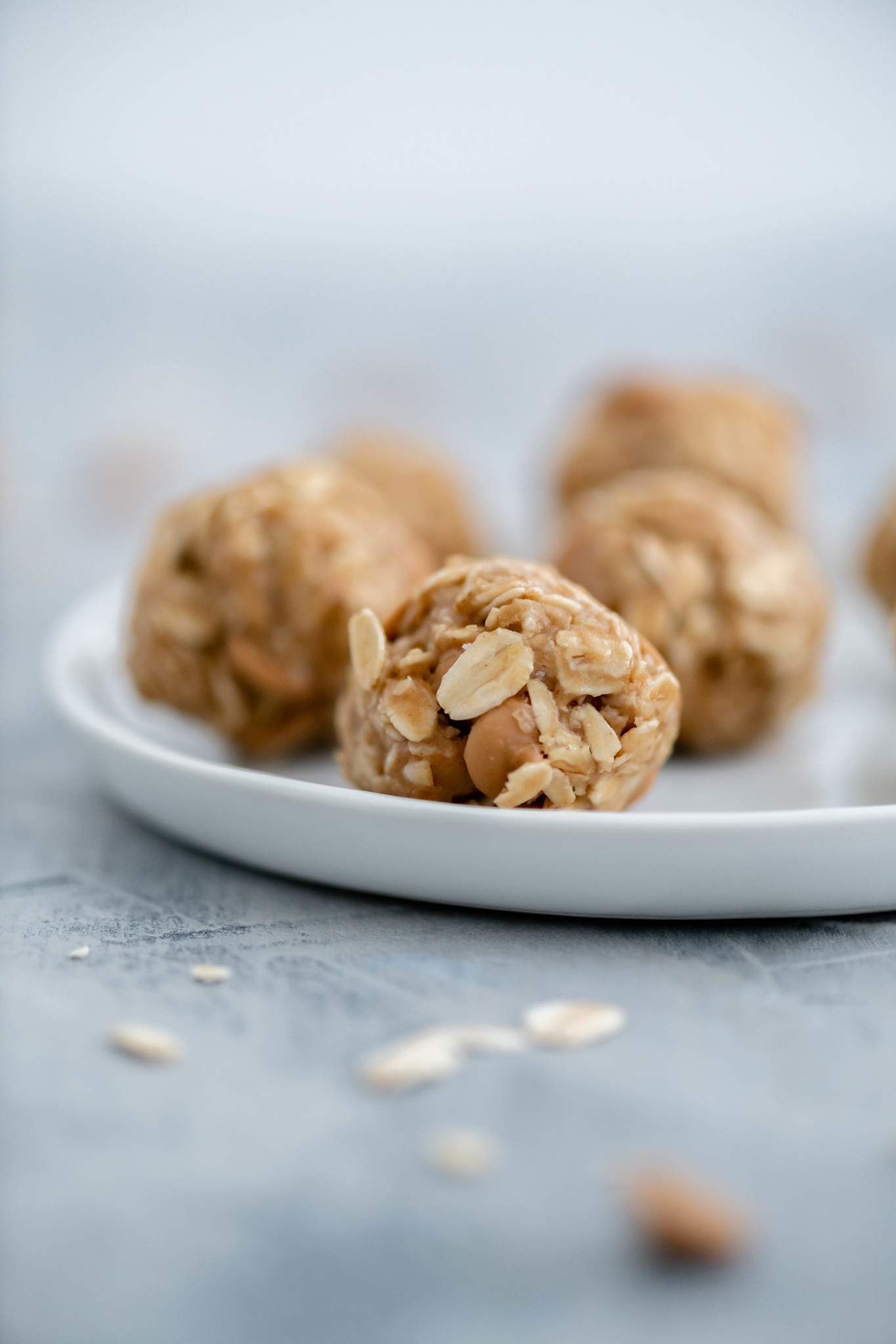 Close up of peanut butter ball on a small white round plate.