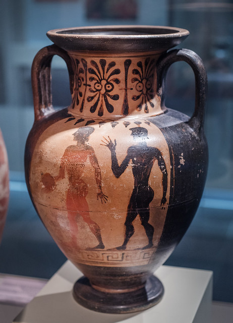 Etruscan Black Figure amphora with representation of chimera and athletes: two athletes, one with discus