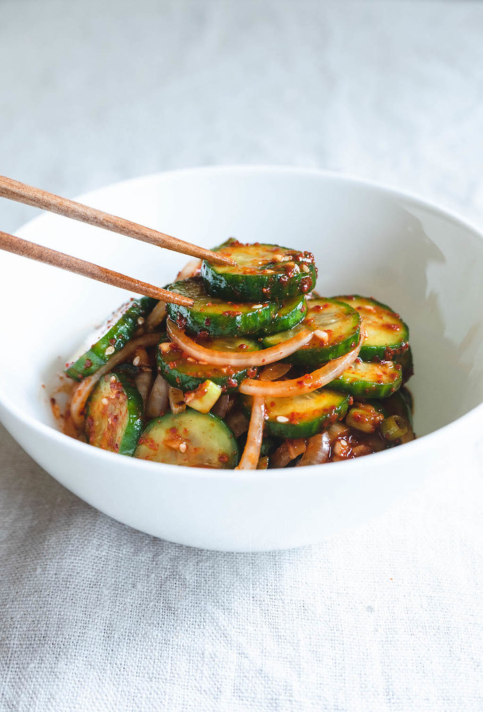 A side shot of Korean cucumber salad in a bowl.