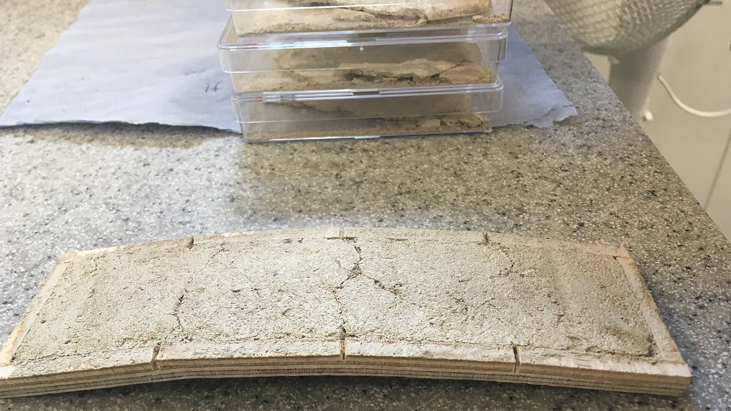 An experiment showing a cracked plaster sample to try to 'heal' the cracks with bacteria.