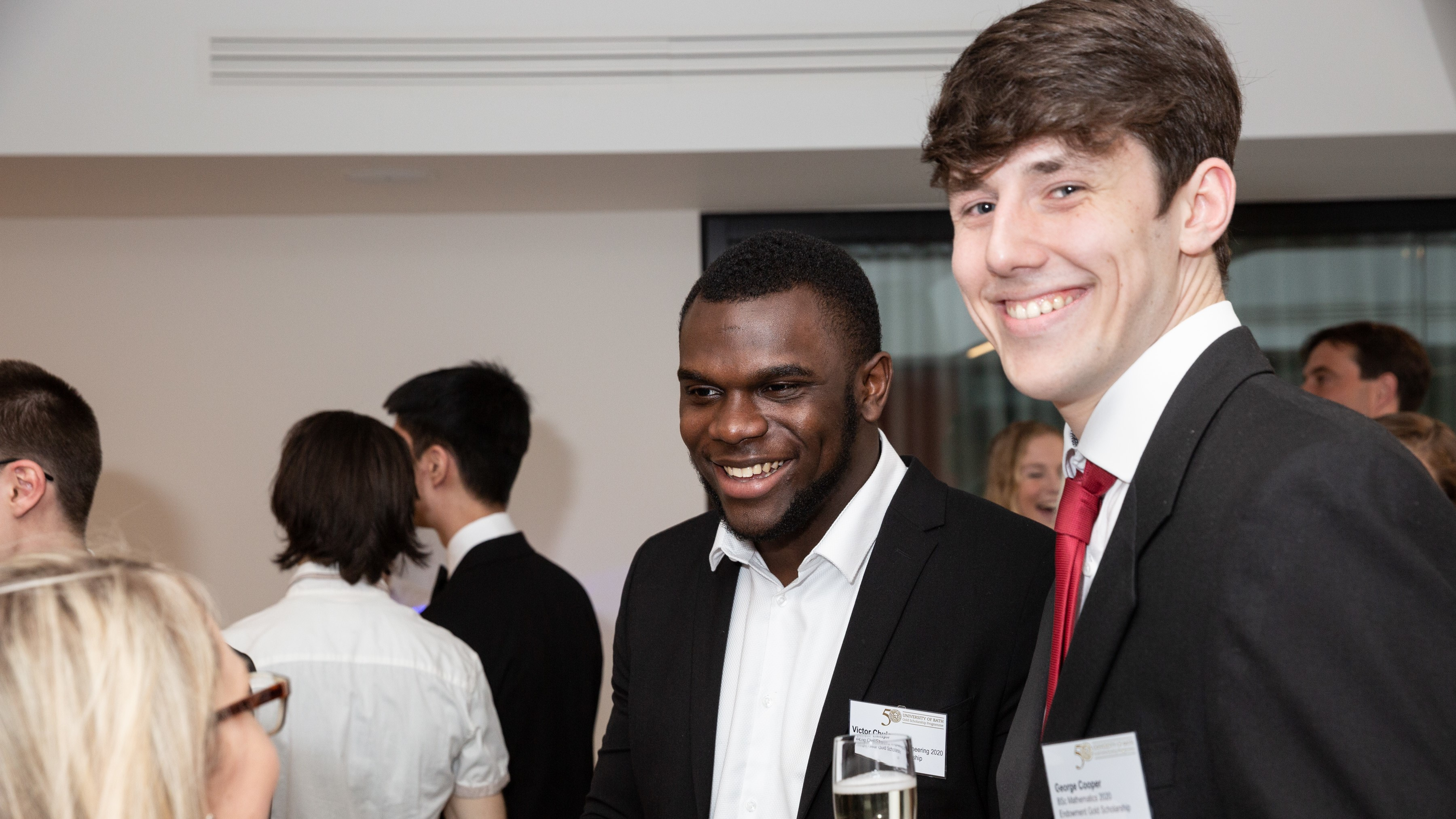 George with another scholar at a networking event