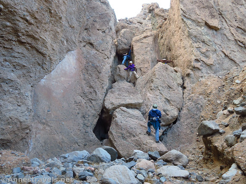 That gaping black hole on the left of the rocks is the easy way into Slot 4a off of Sidewinder Canyon, Death Valley National Park, California