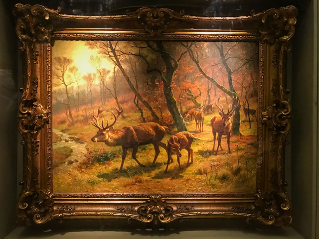 Classical painting of deer in a forest