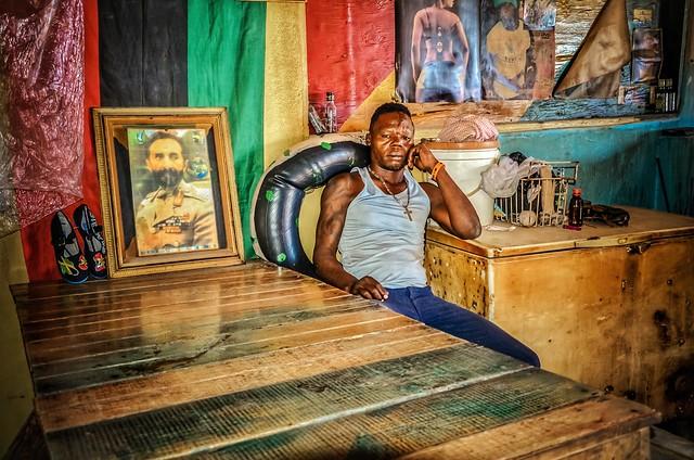 Rastafari. Portrait of a man in bar, Jamaica