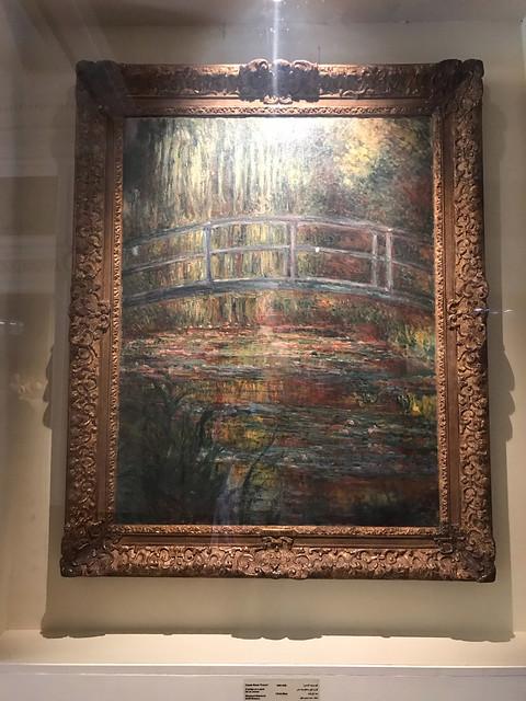A bridge over a pond by Monet