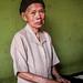 Beautiful elderly Indonesian Woman making rice cookies