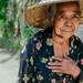 Beautiful elderly woman with straw hat in Indonesia