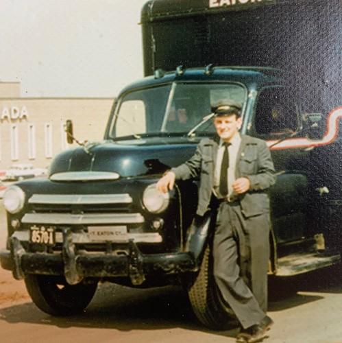 Lloyd Davenport c.1955-58 delivering furniture for Eaton's in Toronto, Ontario