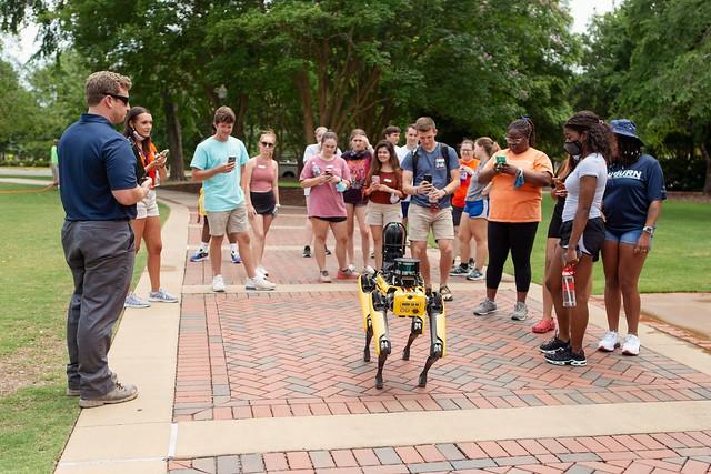 Eric Wetzel and Auburn's robotic dog, Mac, draw a crowd on campus.