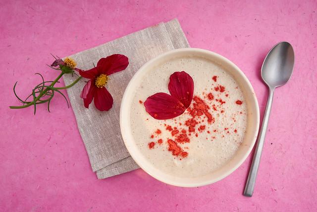 Fruit smoothie and red garnish