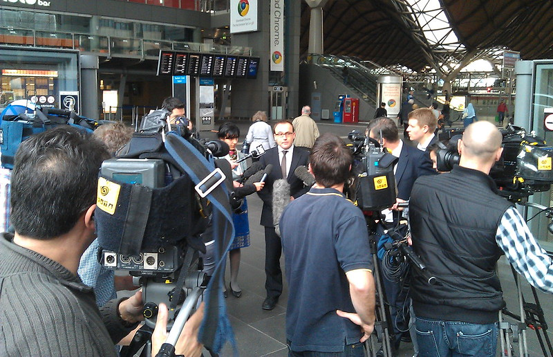 Adam Bandt being interviewed at Southern Cross Station, 2011