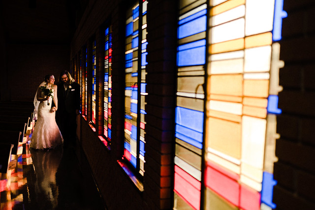 BRIDE AND GROOM AND STAINED GLASS
