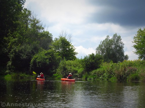 Kayakers on an open stretch of Black Creek.  Much of the paddle is through the forest.  Rochester, New York
